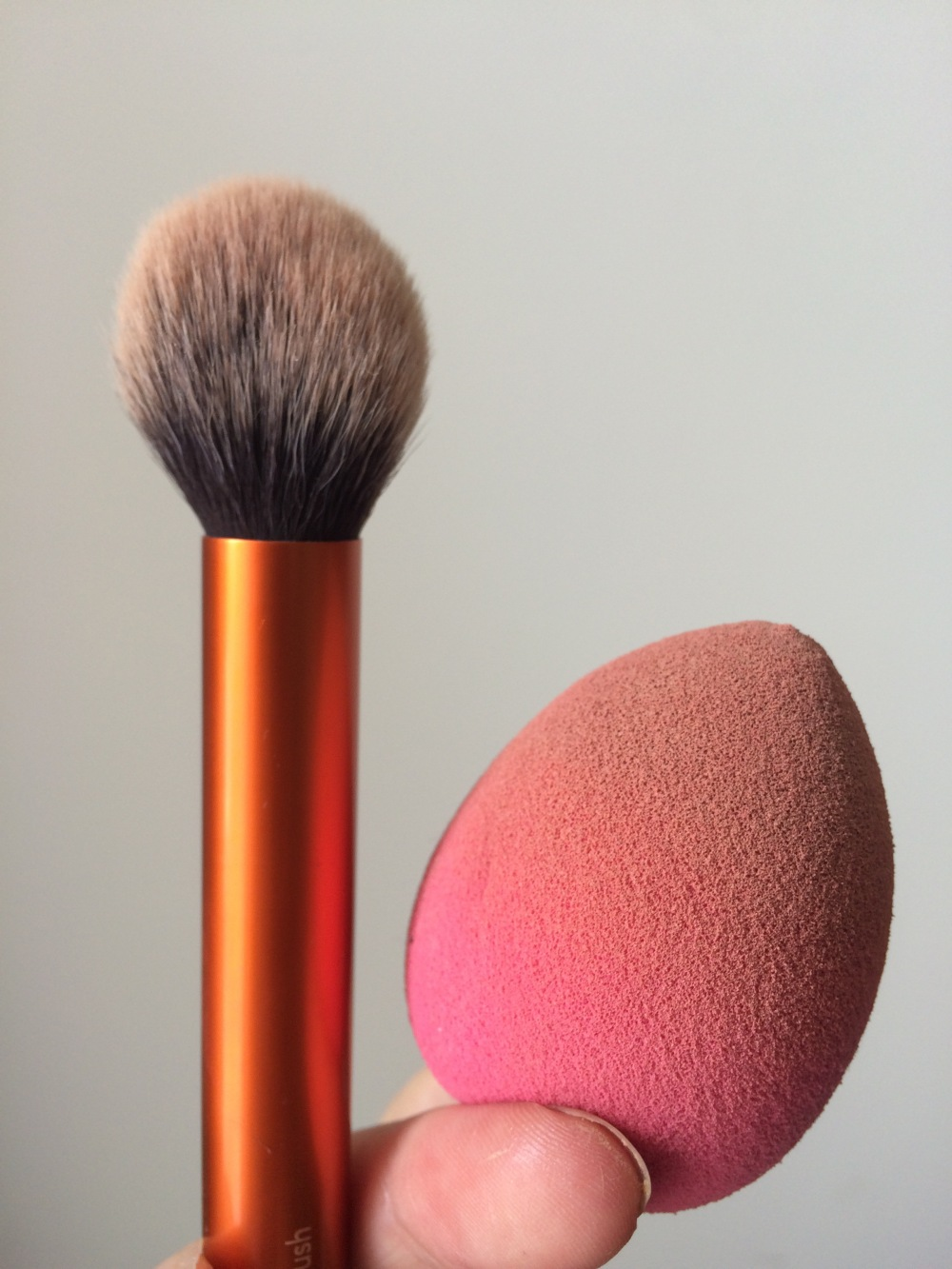 tools for makeup baking with powder . powder brush and sponge