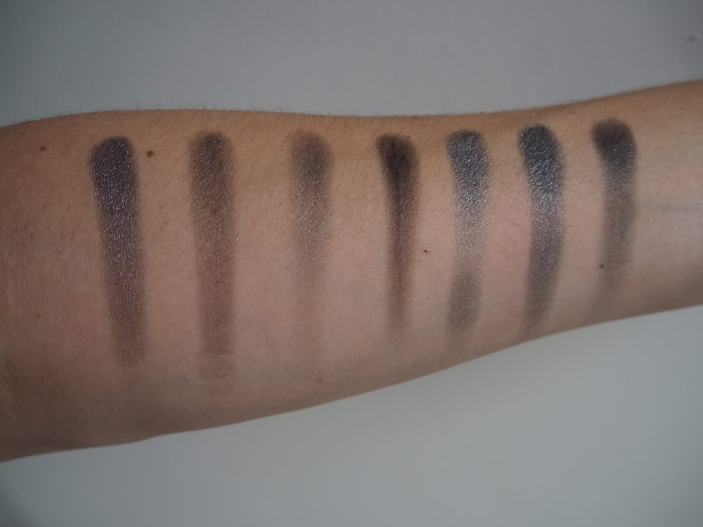 Row of eyeshadow swatches on my arm from Morphe 35d palette Taupes and grey