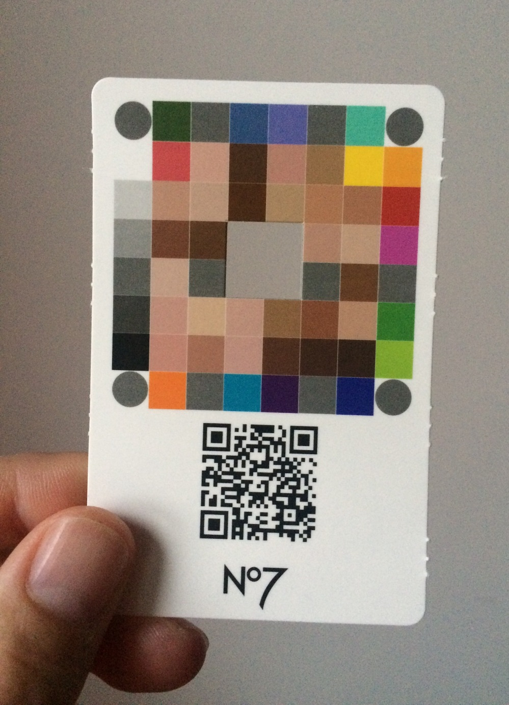 boots no7 match. made foundation shade selection app card, showing a black and white square and a aquare made up of a mosiac of differednt colours with a square hole in the middle