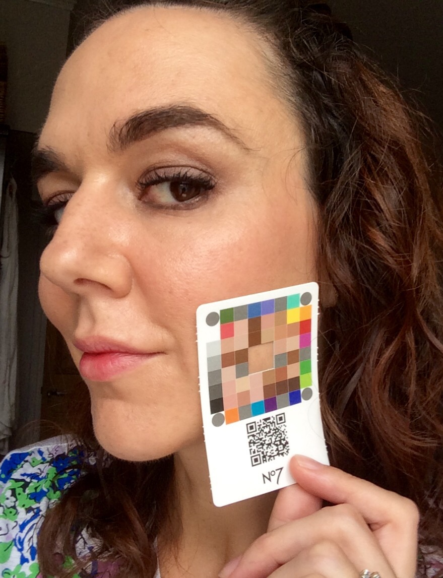 boots no7 match. made foundation shade selection app.  me holding the card against my jawline