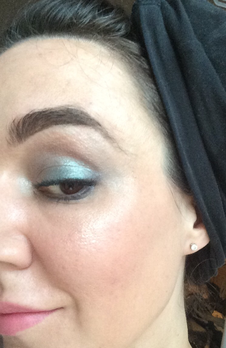 ladies half face with light metallic blue eyeshadow