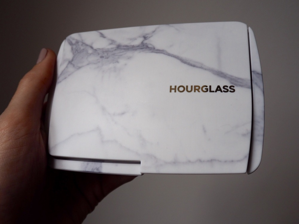 Hourglass Ambient Light Limited Edition Edit Surreal Light Palette Packaging- a chunky oblong compact in marble granite plastic with a matte finish