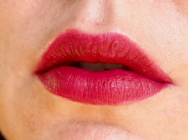 Collection Velvet Kiss Lip Cream in Mulberry close up of lips