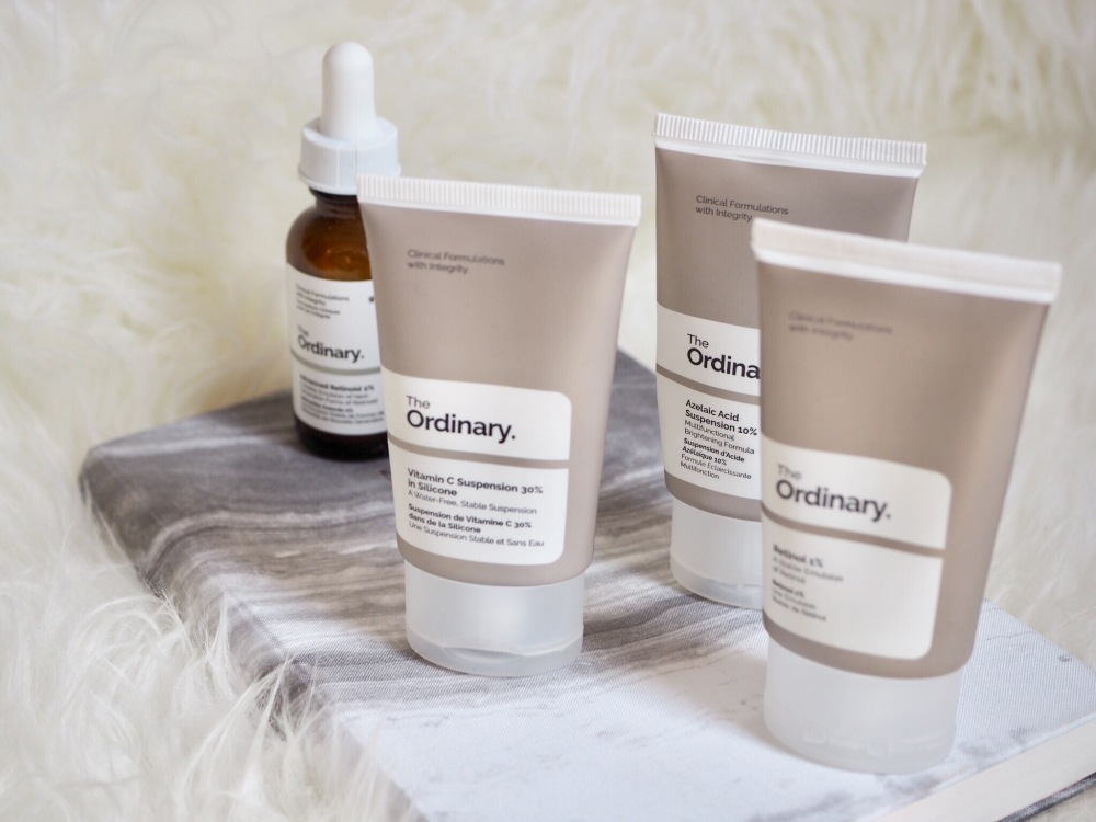 How to Use The Ordinary skincare by Deciem- dropper bottles and a notebook