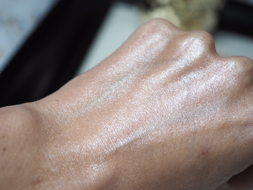 Makeup Revolution Liquid Starlight Highlighter Hand Swatch Blended- really metallic looking hand