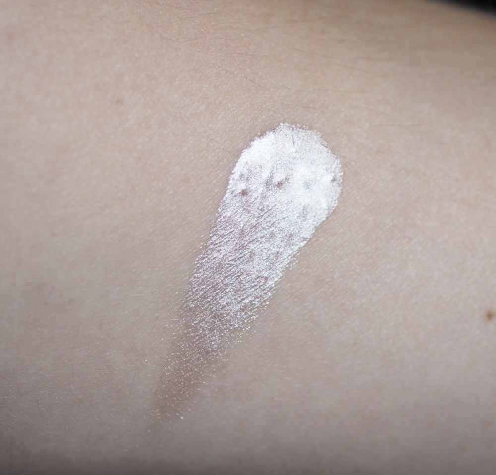 Makeup Revolution Liquid Starlight Highlighter Hand Swatch- a metallic white blob